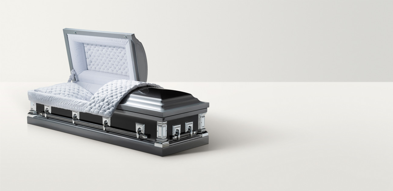 Open twilight silver casket with padded white interior