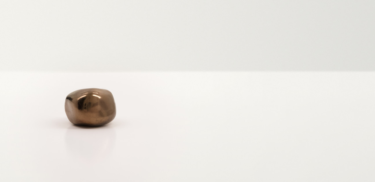 Brown irregular shaped smooth stone