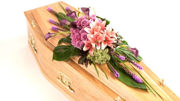 Affection coffin spray in pinks and purples.