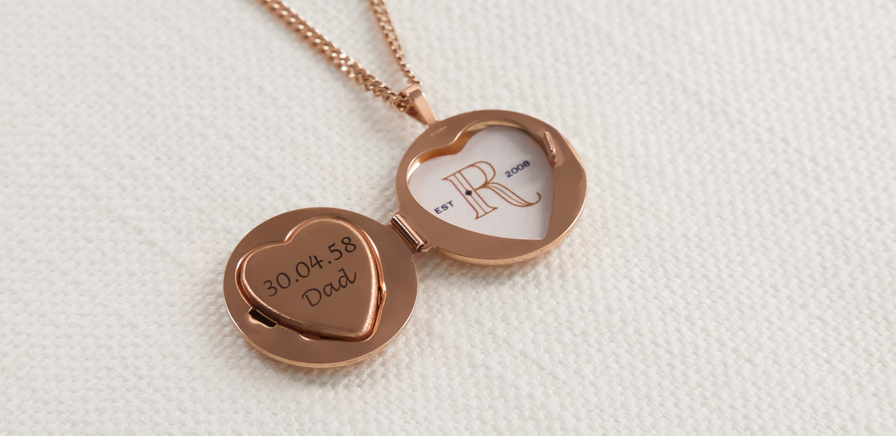 Copper coloured round locket on a chain with engraving inside