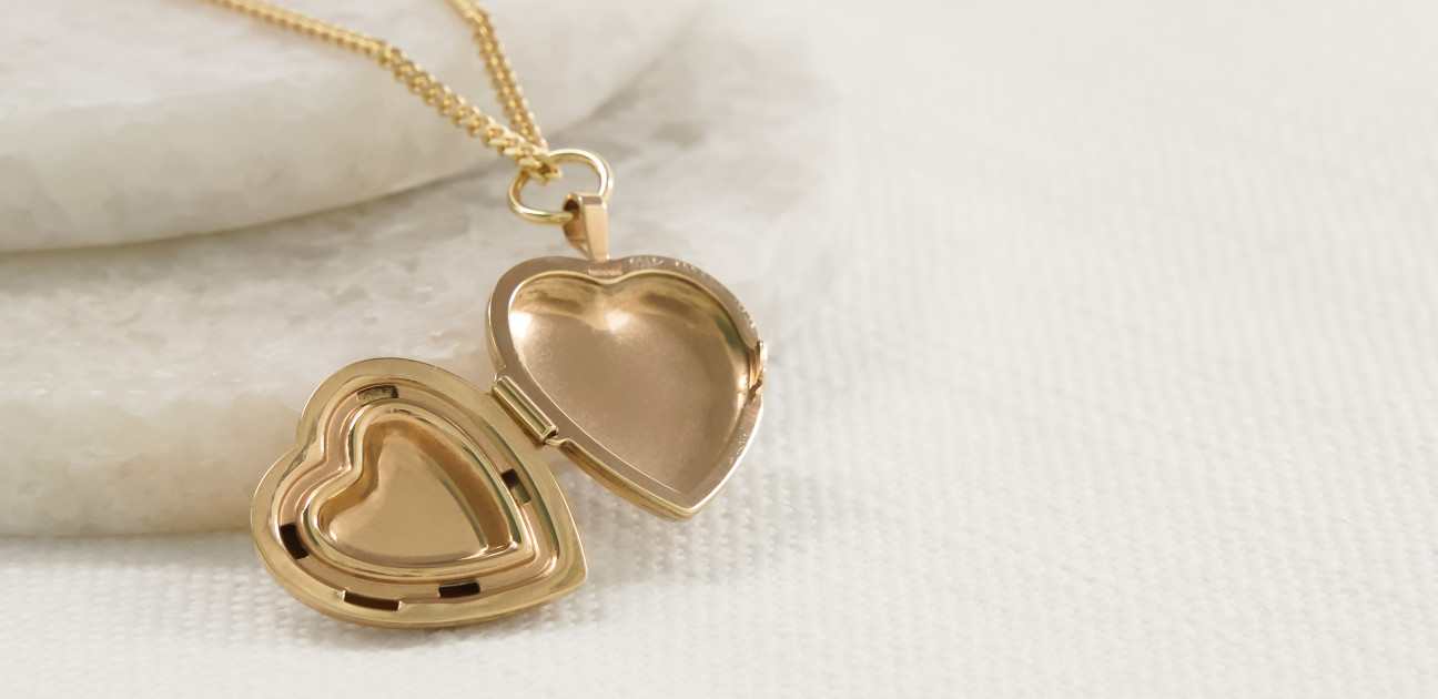 Open heart shaped gold locket on a chain