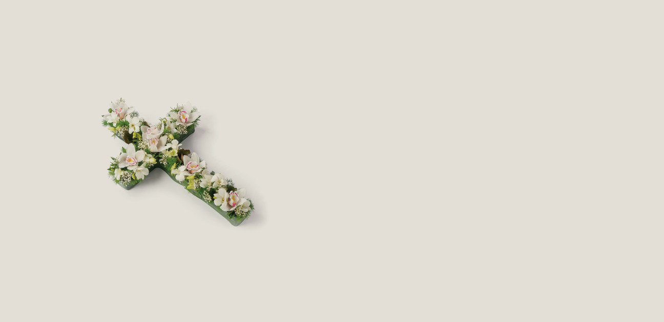 Small cross shaped floral arrangement with white flowers