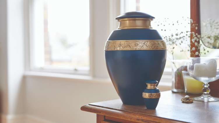 Blue and gold urn placed on a sideboard.
