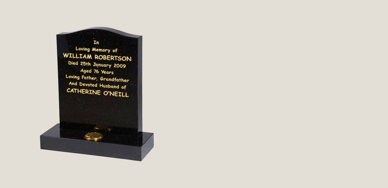 Black memorial with gold inscription