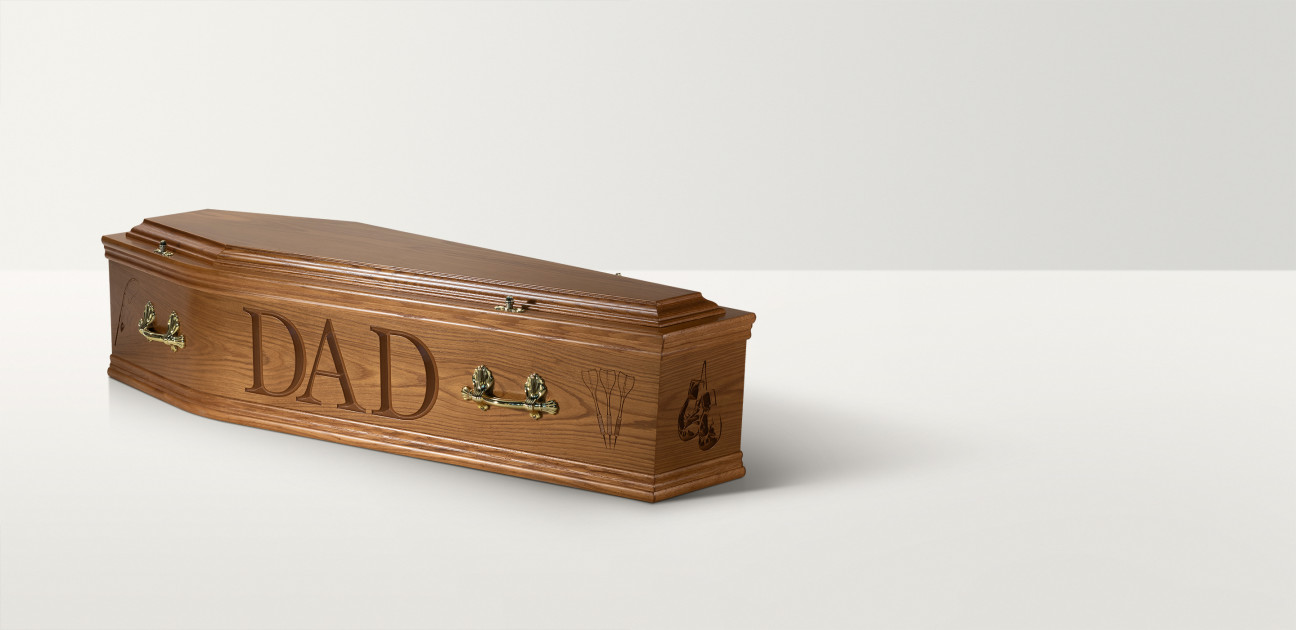 Full length image of a wooden coffin with brass coloured handles and 'Dad' engraved on the side