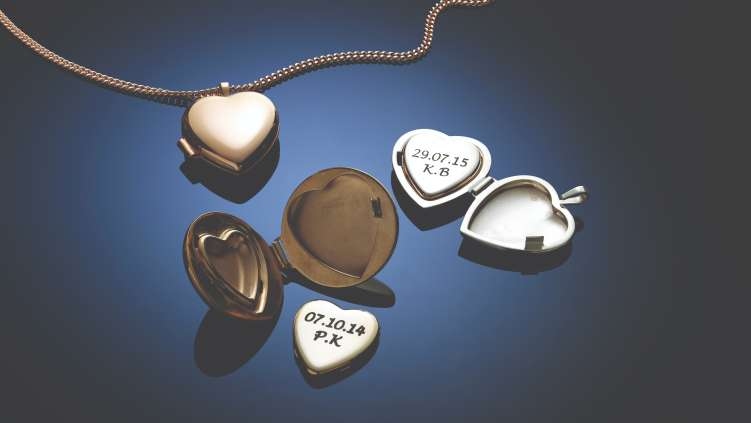 Selection of gold and silver keepsake lockets, some with inscriptions