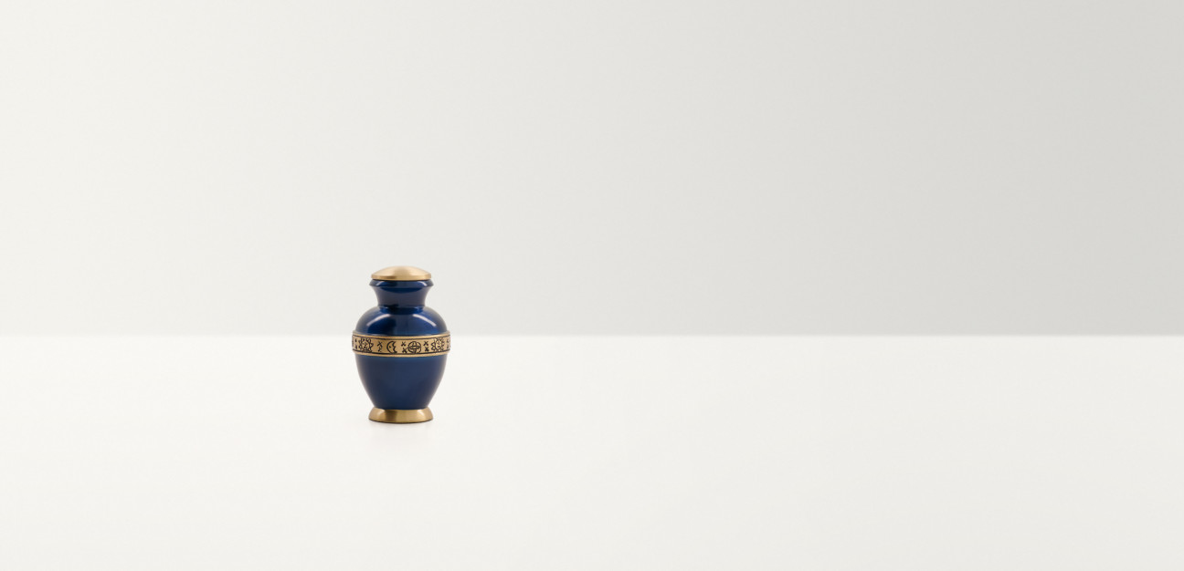 Blue urn with gold coloured band on the base, shoulders and lid