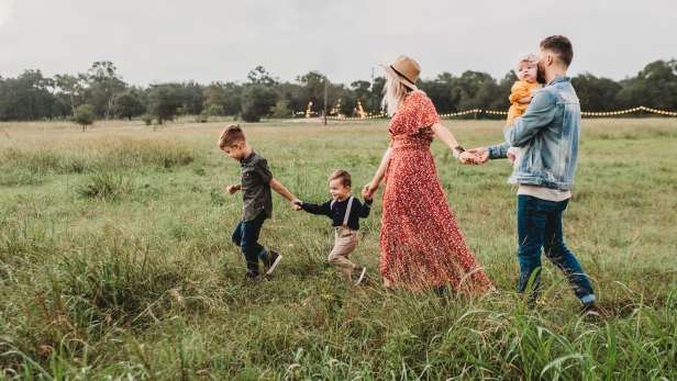 Family walking across field