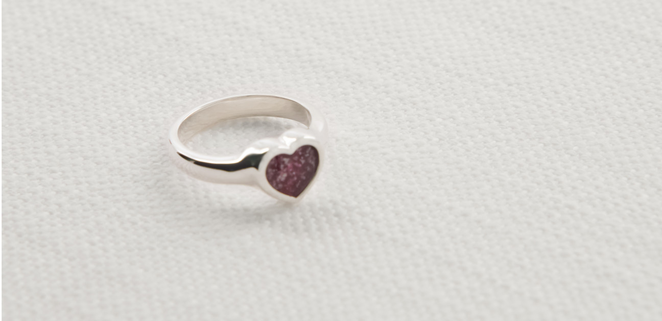 Silver ring with heart shaped mount and red glass centre