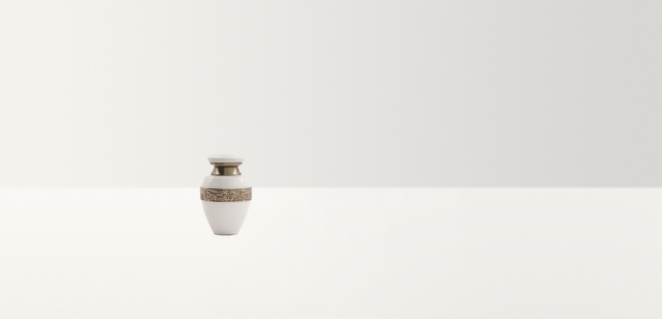 White urn with a gold band