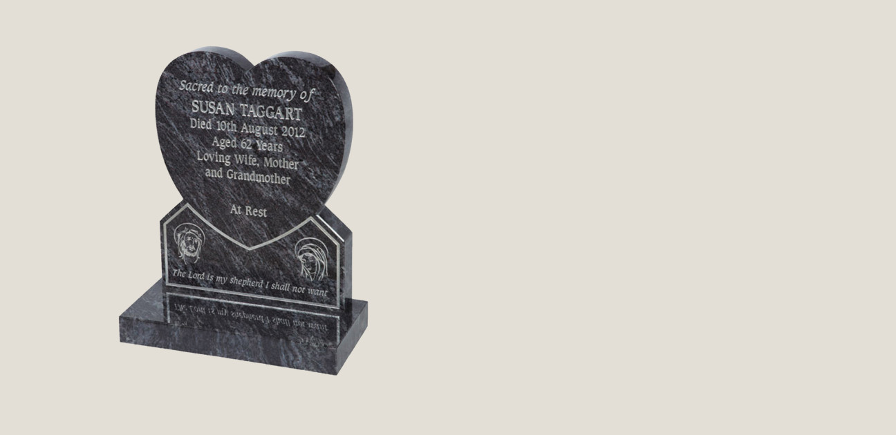 Black stone heart on stand with silver engraving