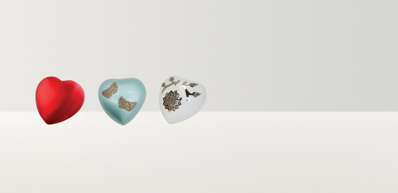 Four heart shaped ornaments in a variety of designs