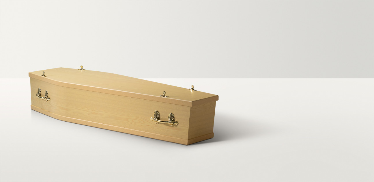 Standard shaped maple wood coffin with brass handles and closures