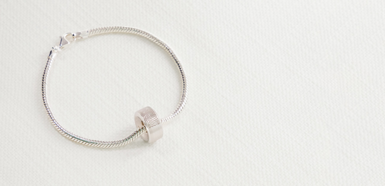 Silver chain bracelet with a round silver charm