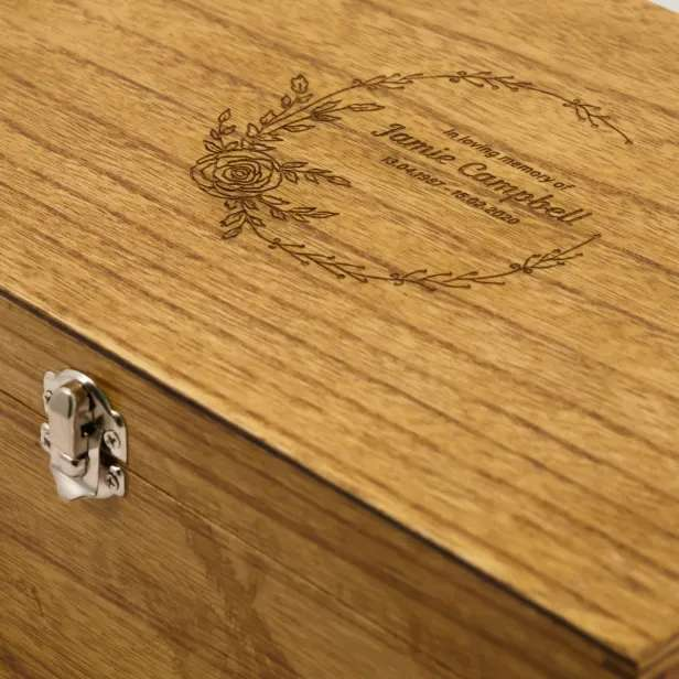 Close up of wooden box with engraved lid