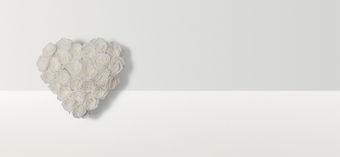 Heart shaped flower arrangement with white roses