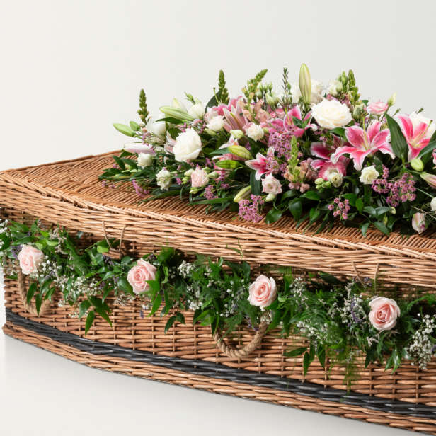 Woven coffin with grey stripe detailing and floral garland and spray