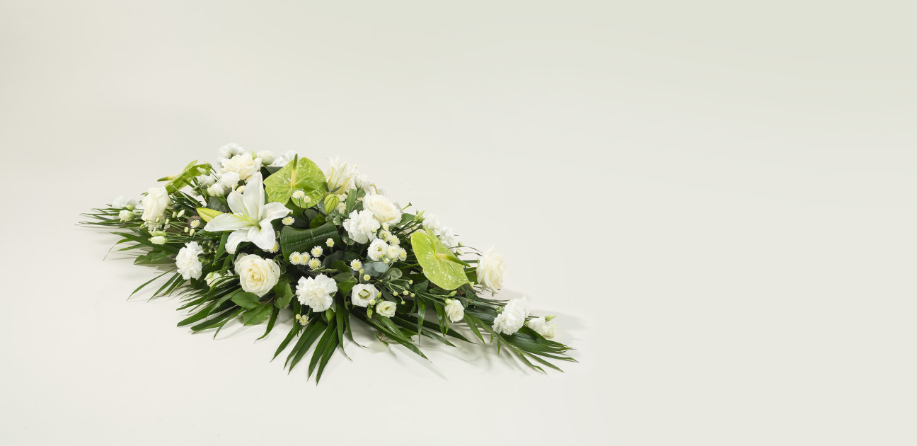Woodland coffin spray with white flowers and green foliage