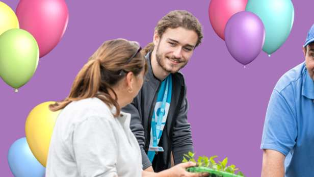 Image of volunteer with balloons in the background