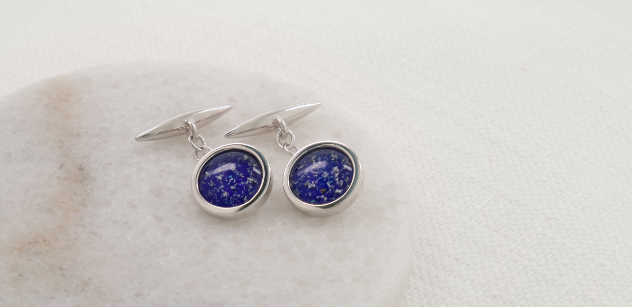 Silver cufflinks with blue glass centres