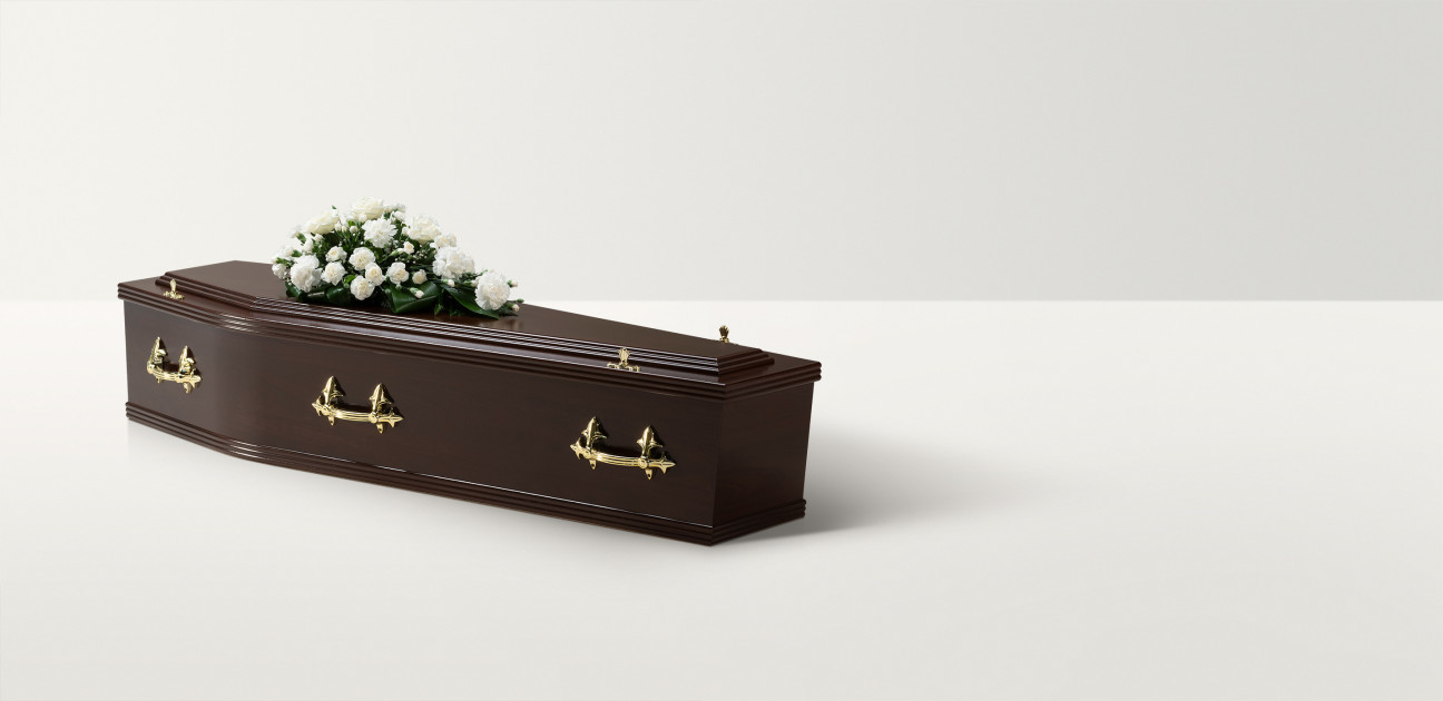Rosewood coffin with a floral arrangement