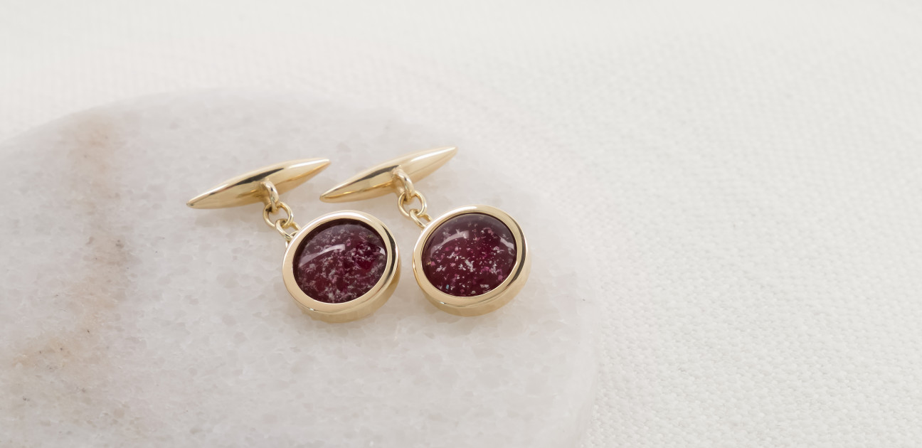Gold cufflinks with red glass centres