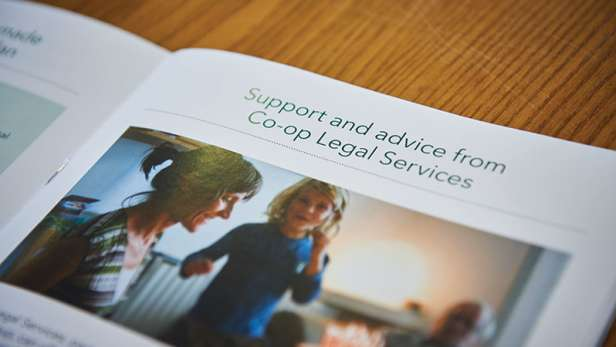 Legal services brochure open on support and advice page.