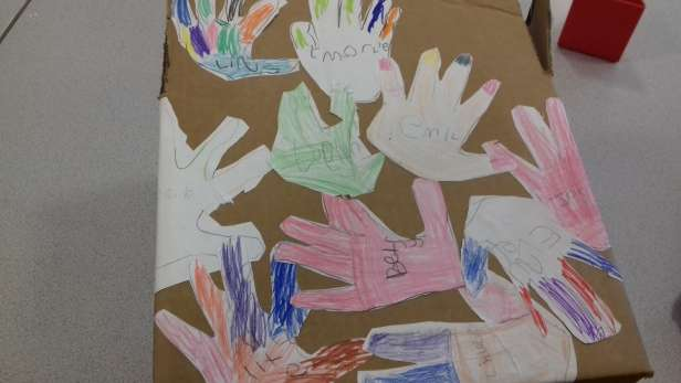 Children's collage of hand designs.
