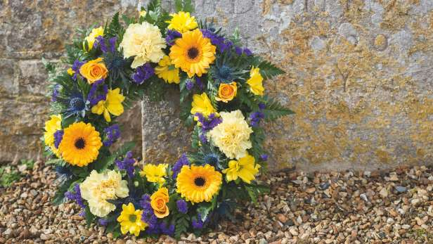 Wreath arrangement in yellow and purple