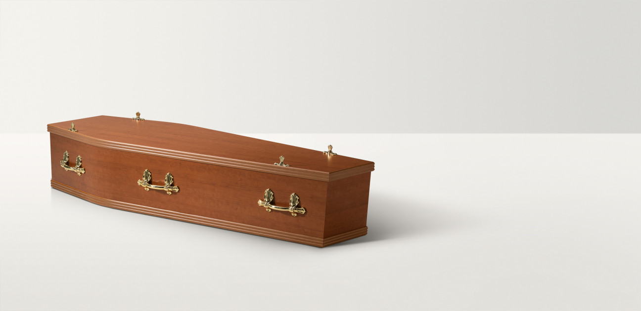 Full length image of a cherry wood coffin with brass handles and closures
