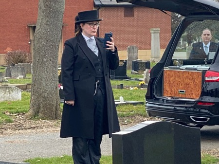 Funeral Director Live Streaming a Funeral