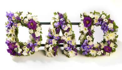 Dad tribute in a floral arrangement with purple and white flowers.
