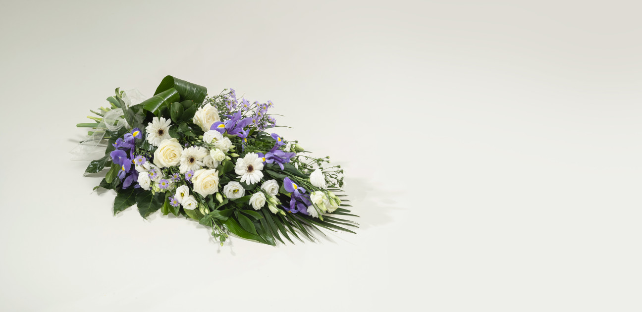 Purple and white sheaf floral arrangement