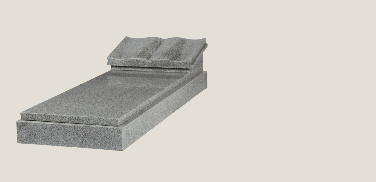 Kerb set with book and ledger in grey stone