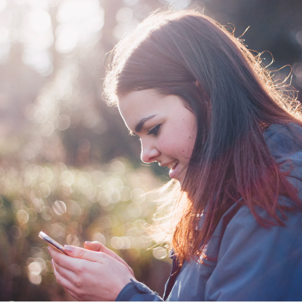 Image of a girl using her phone
