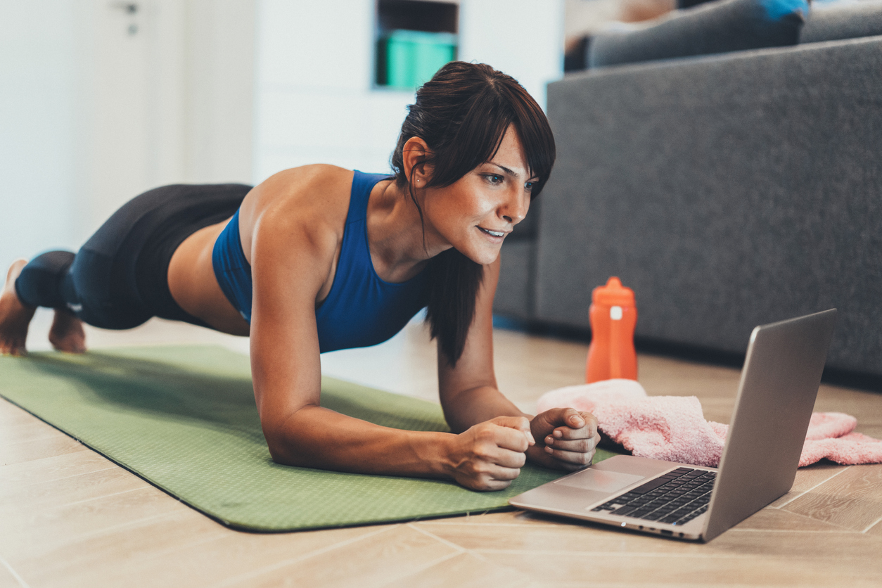 How to get fit for free - woman doing workout at home
