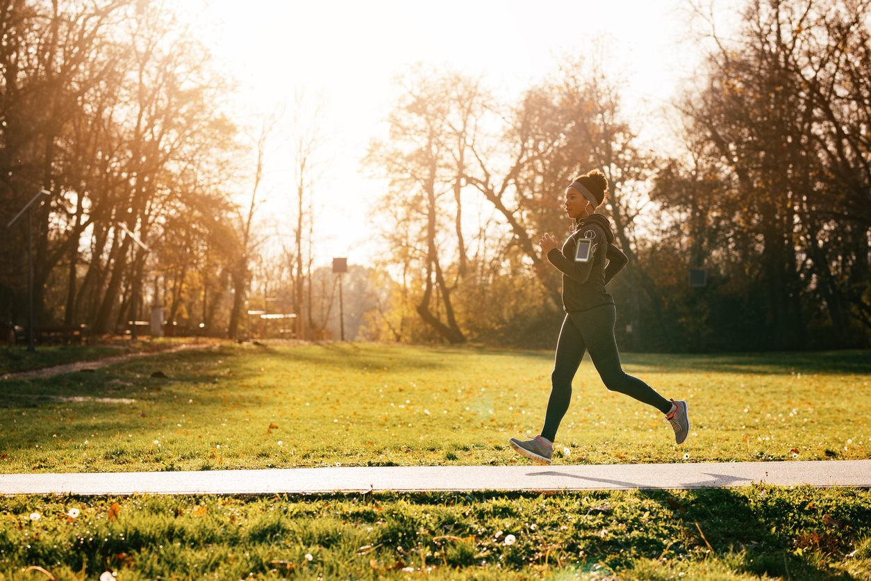 Young woman running in a park in the winter sun (credit - Drazen Zigic)