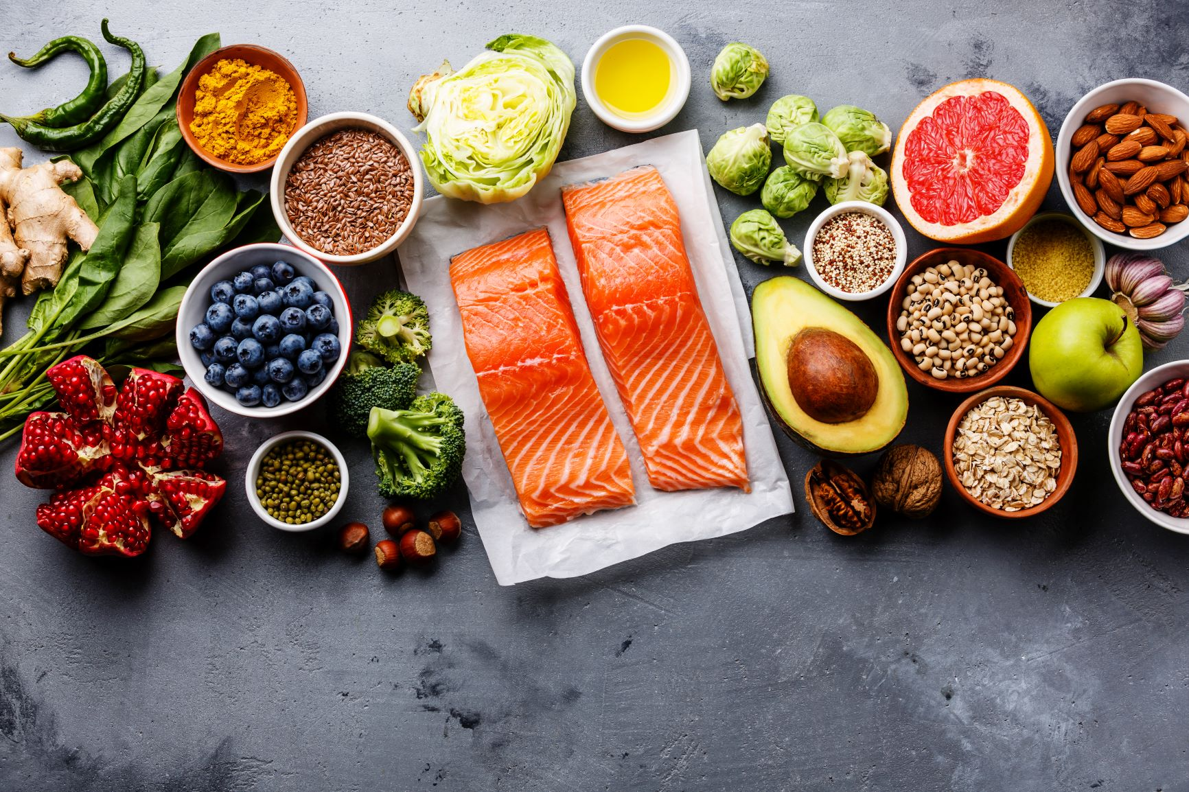 Health foods on a worktop including salmon