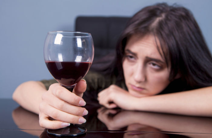Woman gazing at red wine