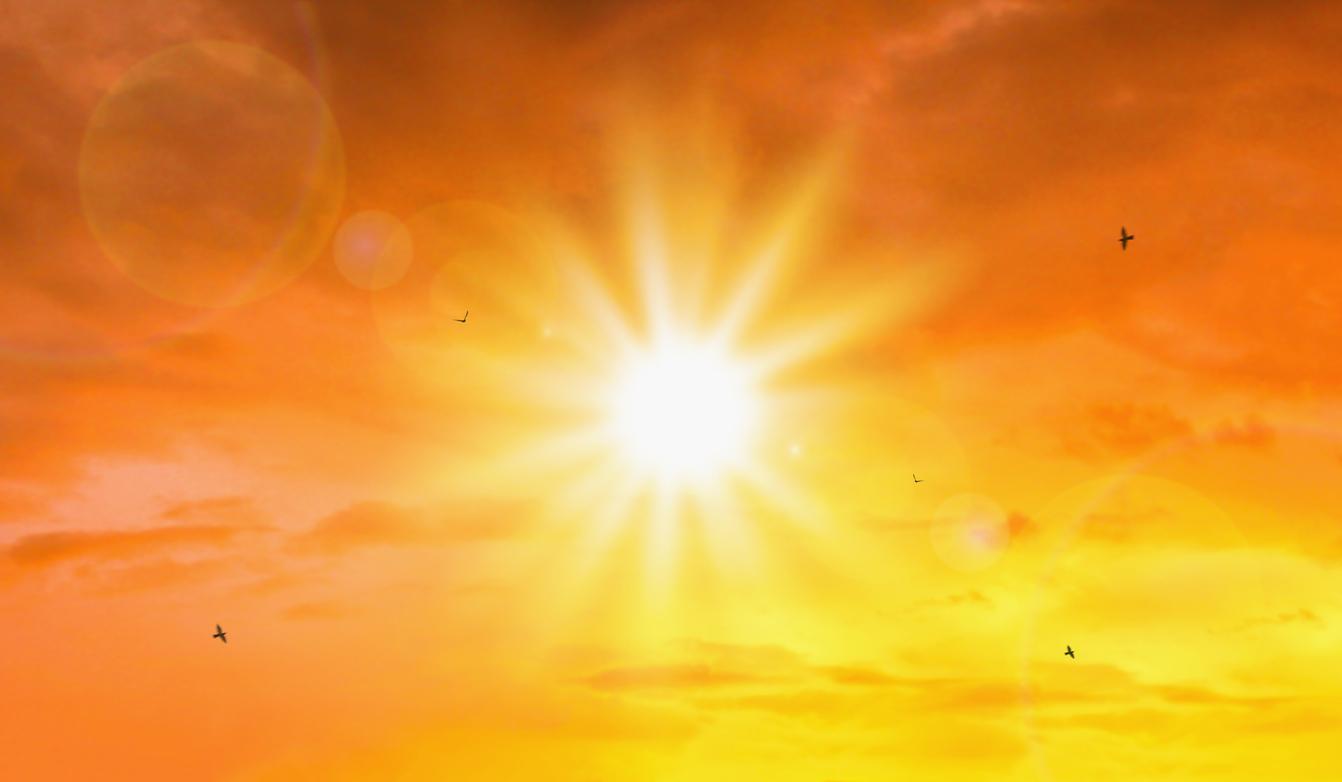 Hot sun streaming through clouds