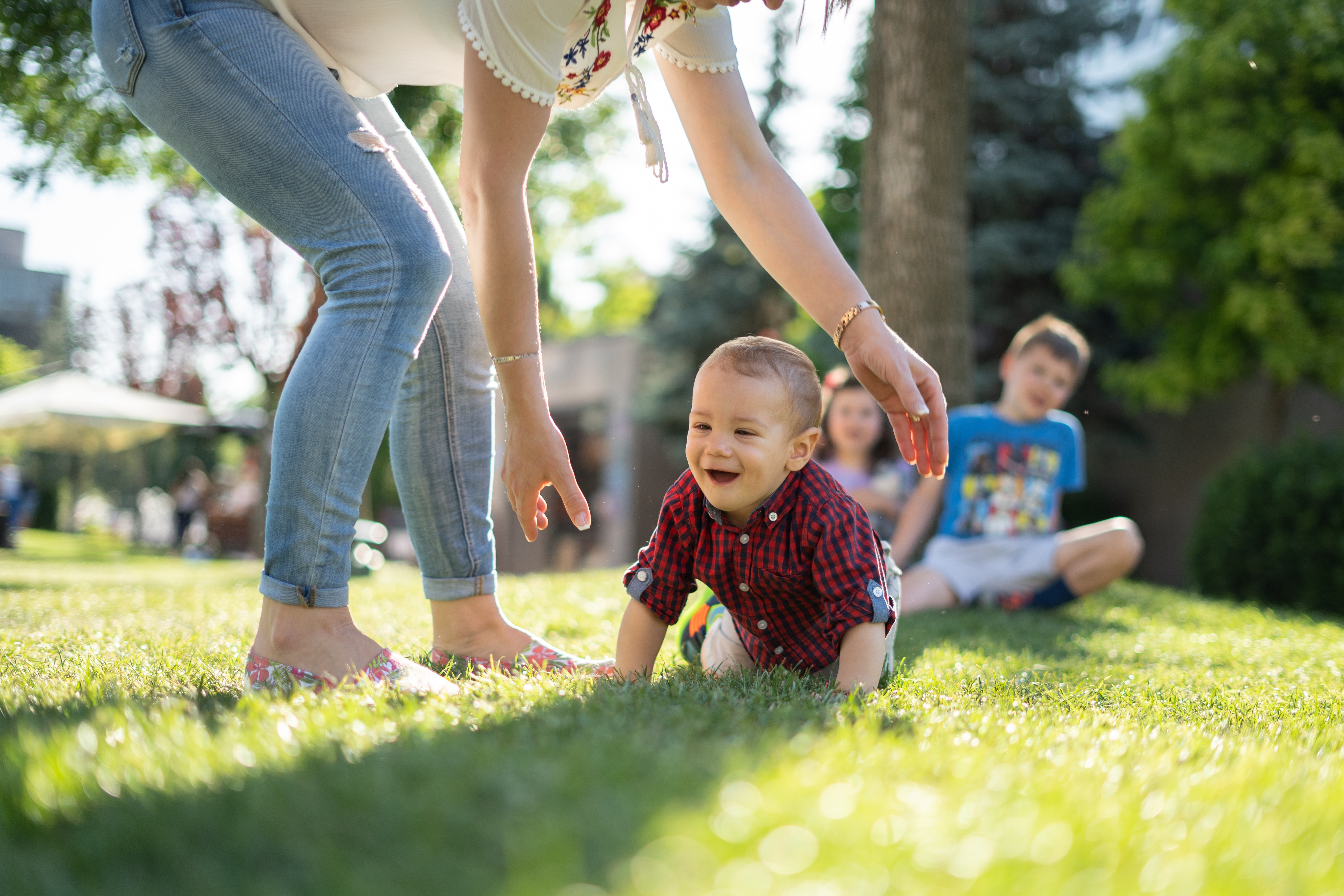 Baby crawling on grass