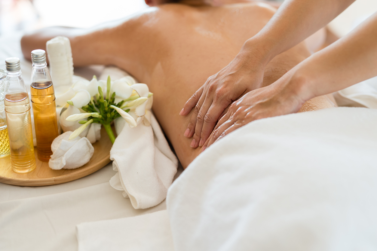 Woman having a massage using essential oils in a salon
