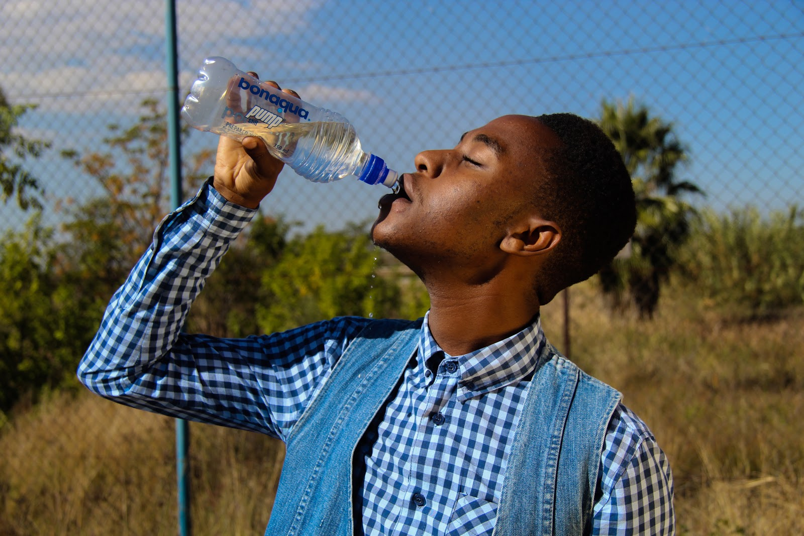 man-drinking-from-water-bottle