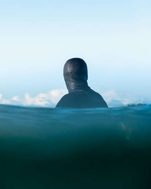 Peter Devries waits in the water in full surf gear