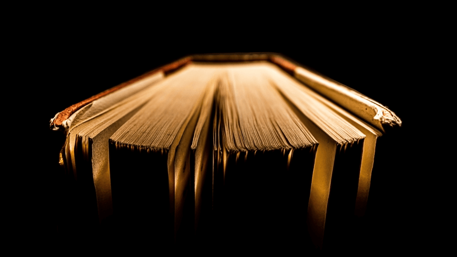 Old book lit from above.