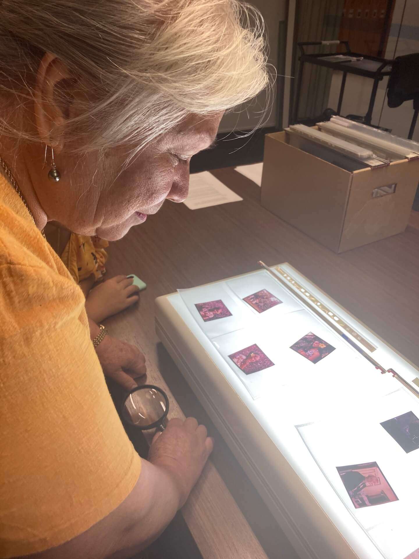 Woman looking at slides on a table