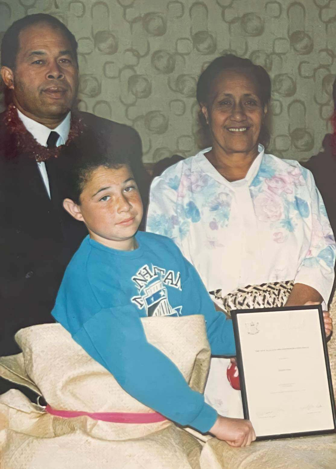 Man, woman and child with certificate