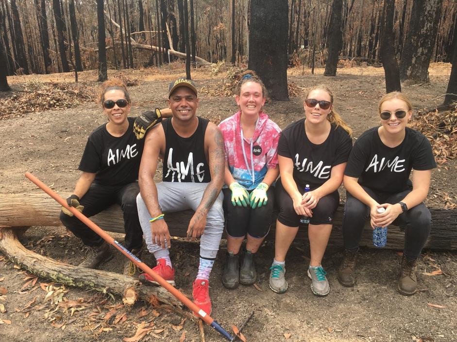 AIME Volunteers help to clean up after bushfire damage in Batemans Bay