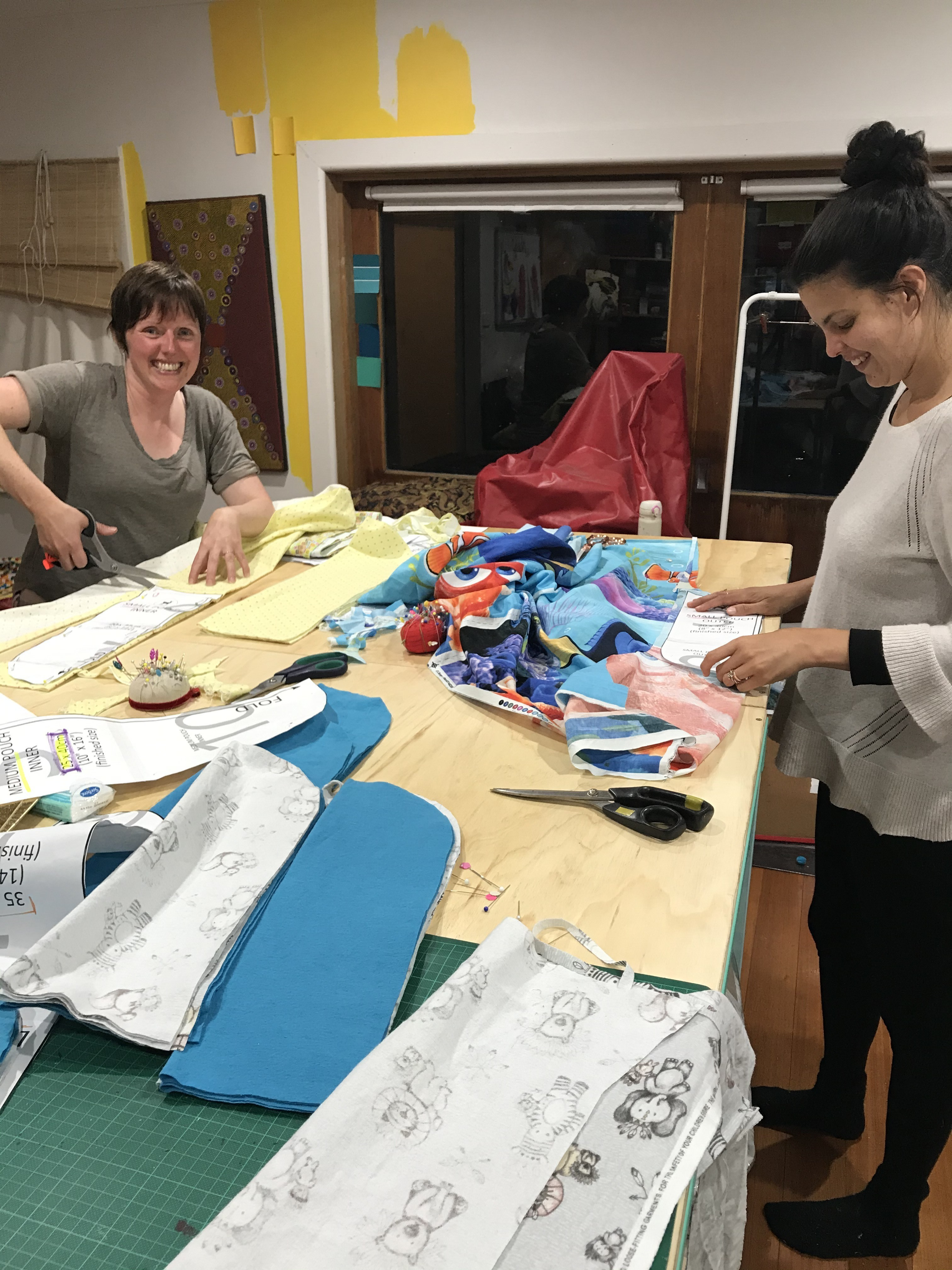 11 January 2020 - Coburg Victoria - Ronella Gomez right and Louise Pacor cut fabric pouches from patterns downloaded from