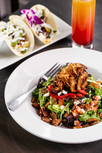 Azalea Kitchen's Blacksmith Steak Salad: Mixed greens, blackened steak tips, goat cheese crumbles, roasted red peppers, tomato, candy pecans, and crispy fried onions.